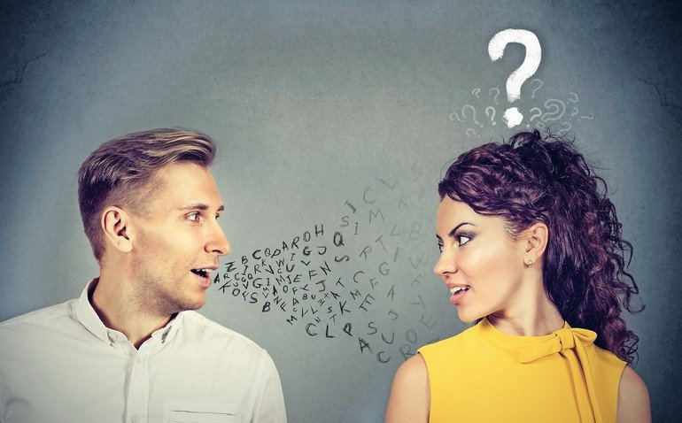 Man_talking_to_an_attractive_woman_with_question_mark_