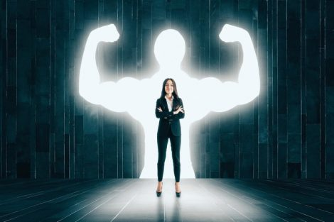 Businesswoman_with_muscly_arms_in_concrete_interior._Confidence_and_power_concept