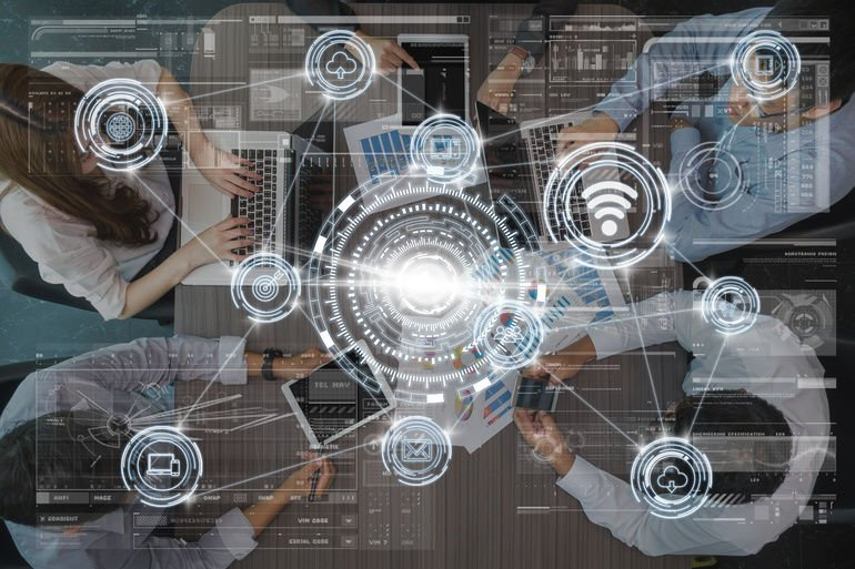 technology_digital_virtual_screen_and_Wireless_communication_connecting_over_the_Top_view_of_Business_People_Group_on_a_Meeting_in_the_modern_office,_technology_business_internet_of_thing_concept