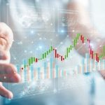 Businessman_on_blurred_background_using_3D_rendering_stock_exchange_datas_and_charts