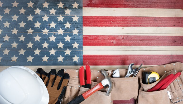 Labor_Day_background_with_USA_rustic_wooden_flag_and_utility_belt_plus_hard_hat__