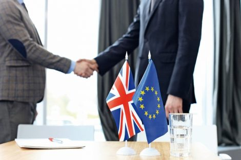 European_Union_and_United_Kingdom_leaders_shaking_hands_on_a_deal_agreement._Brexit